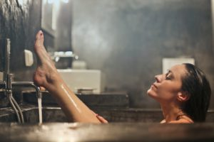Woman relaxing in a hot bath