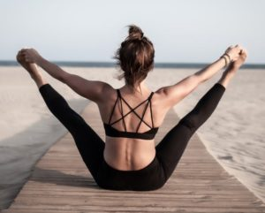 A woman stretching at the beachStretch