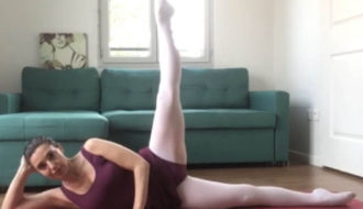 A woman doing floor barre