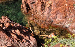 French Riviera vacation-woman swimming in small creek