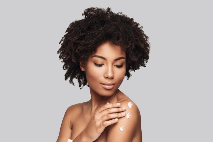 Immune system-woman moisturizing her skin