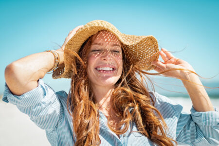 Immunity boost-woman with a summer hat soaking in sunlight